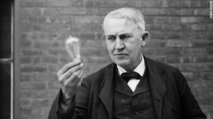 Edison holding vintage lightbulb outside